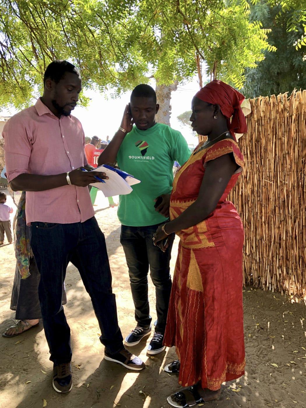 Local staff and translator communicate Senegelese smallholder.