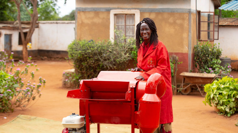 Wide Shot An Entreprenuer Beside A Cereal Thresher In Makindu(1)